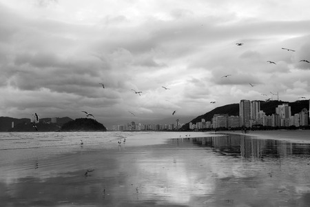 Santos beach photographed in black and white during a cloudy day, Brazil