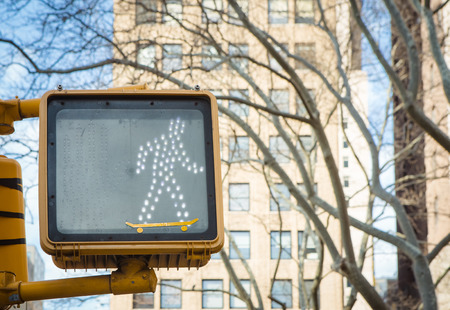 Intervention at a traffic light in New York with an adhesive transforming the pedestrian into skater. Banco de Imagens