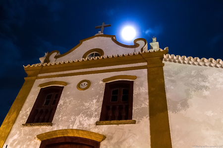 The Chapel of Senhor Bom Jesus da Pobreza is a Catholic temple in the city of Tiradentes, Brazil, built in the Baroque-Rococo style and is in the main square of the city. Detail of the facade with the full moon