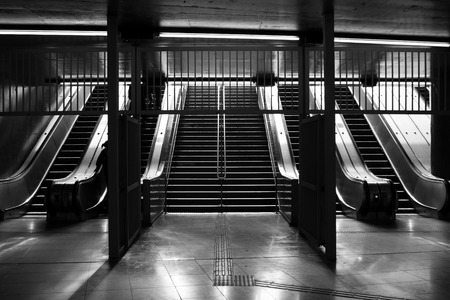 Inside view of the Sao Paulo subway staircase in black and white.