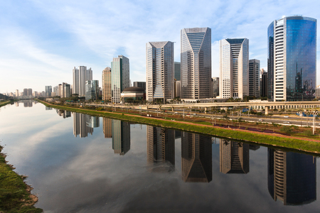 Pinheiros  river in Sao Paulo, Brazil, with modern buildings and their reflections in the water.