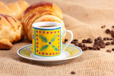 Breakfast with Italian bread, cheese bread, chocolate donut, coffee and croissant. Stock fotó