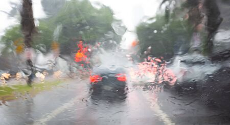 The danger of lack of visibility in traffic on rainy days.