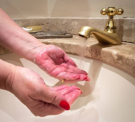 Woman washing hands for the prevention of coronavirus, covid-19.