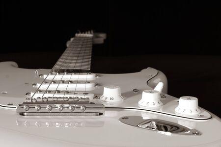 Electric guitar detail on a black background. Banco de Imagens