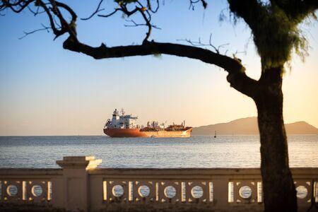 Oil-Chemical tanker leaving the port of Santos during sunset, Brazil.
