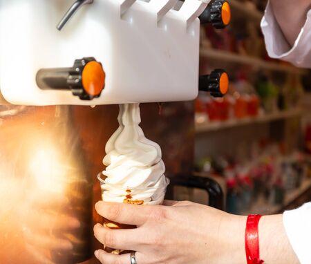 Preparation of vanilla ice cream, frozen in the glass.