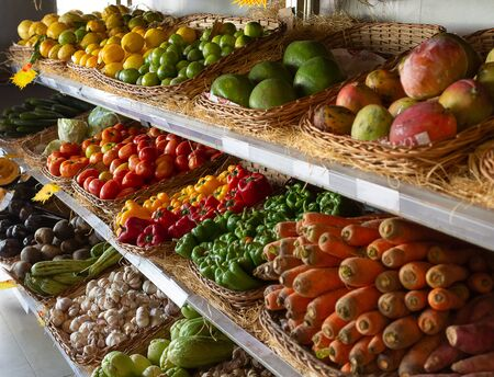 Fruits and vegetables displayed for sale in a grocery store in Brazil.
