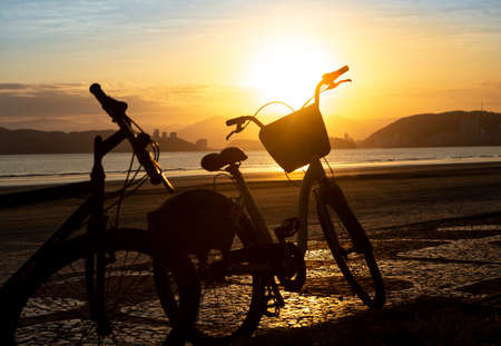 Silhouettes of bicycles photographed during the sunset in Santos, Brazil.