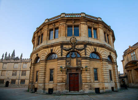 The Sheldonian Theatre from Broad Street in Oxford with no people. Early in the morning. Oxford, England, UK.