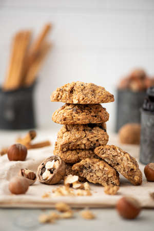 stack of oatmeal cookies with dried fruits and nuts on towel