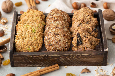various oatmeal cookies with nuts, dried fruits and candied fruits in wooden box Stock fotó