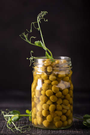 canned green peas in a glass jar