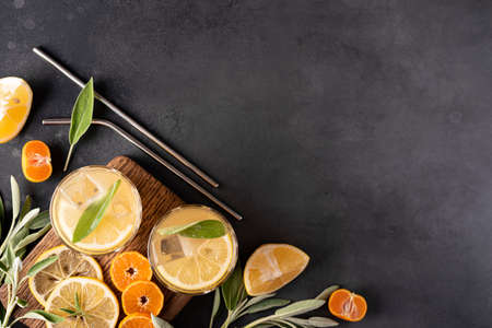 homemade lemonade with lemon slices and ice in glasses, top view Stock Photo