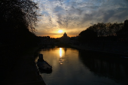 A shot of a sunset over the Tevere river in Rome photo