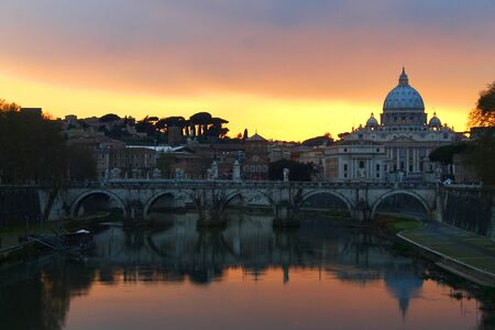 Colored sunset with the river and the church in Rome