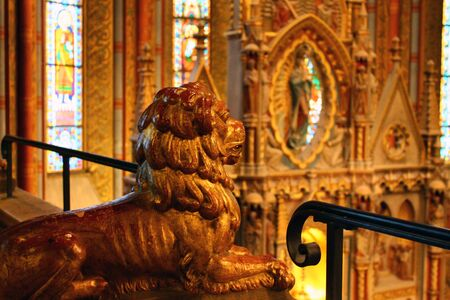 The yellow stone lion in a church in Budapest