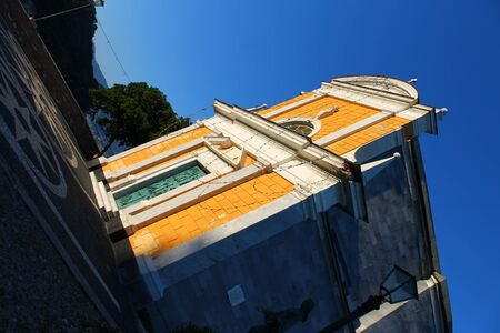 Yellow church and blue sky in Italy