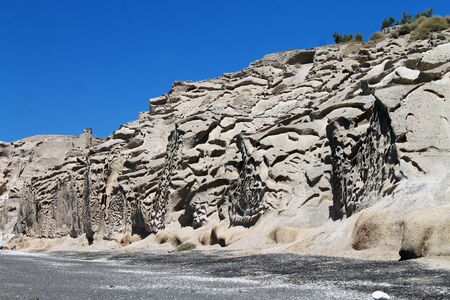 Layered brown cliff and rocks in Greece