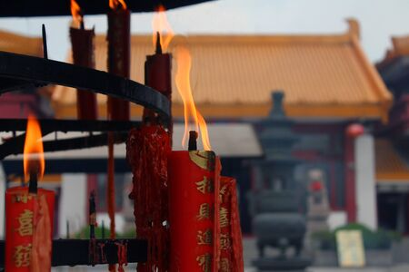 Close up of a burning asian candle