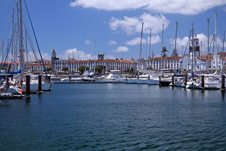 Ponta Delgada harbour with sails and typical architecture