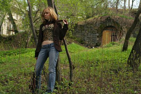 Beautiful girl walking in green park photo