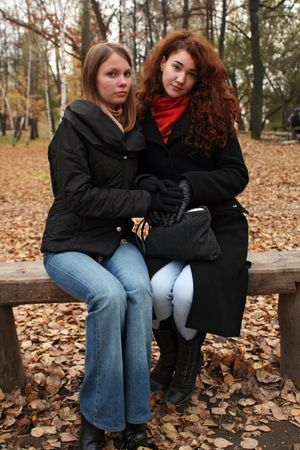 industrious: industrious sisters sitting at park