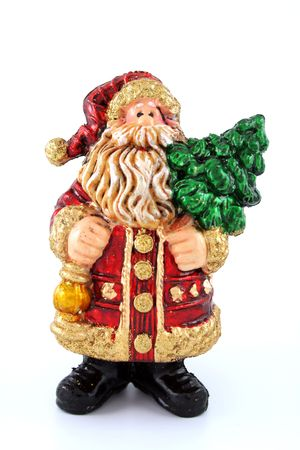 Santa Claus toy statuette - it`s holding green fir photo