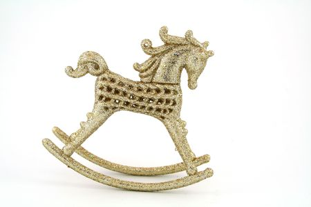spangles: gilded with spangles rocking horse isolated on white