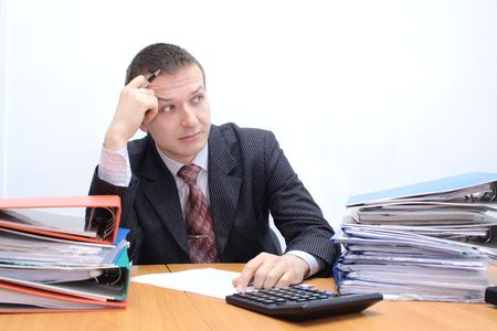 office physical pressure paper: Businessman is stressed with large paperwork and has headache