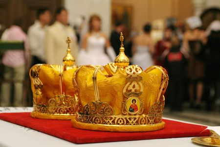 love dome: Two orthodox crowns prepared for wedding ceremony