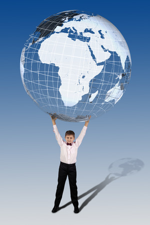 discard: Boy in bow tie holds over his head a large semi-transparent globe on a blue background. Stock Photo