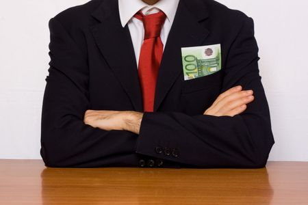 breast pocket: businessman with money on his breast pocket Stock Photo