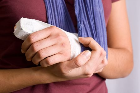 girl with an injured hand photo