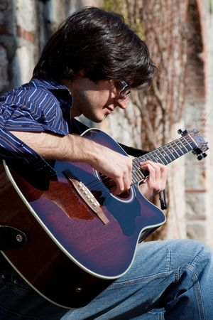 man and his acoustic guitar  photo