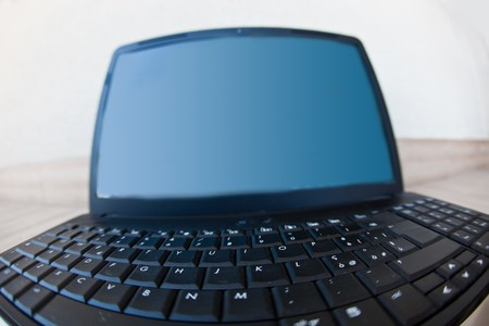 warped view of a laptop keyboard photo