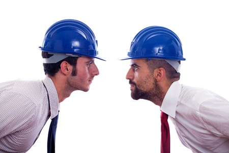 Two Engineers with Helmet and Necktie Dare Each Other photo