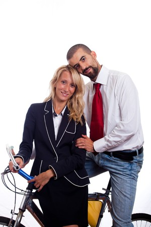 Young Businessman and Businesswoman on a Bike photo