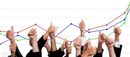 winning business woman: Business People with Thumbs Up Against Financial Growth Chart Stock Photo