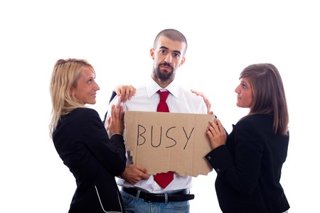 Businessman Hold Busy Sign with Two Businesswoman Flirting photo