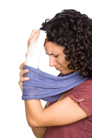 broken arm: Young Woman With Injured Hand Stock Photo