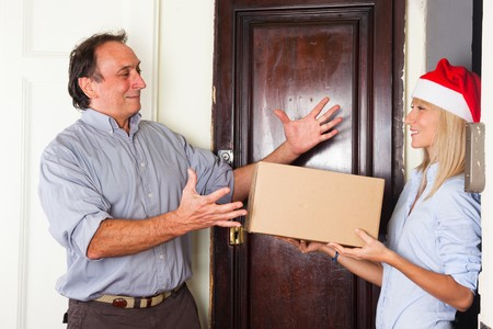 Man Receive a Box from Young Woman with Christmas Hat photo