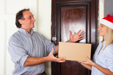 Man Receive a Box from Young Woman with Christmas Hat Stock Photo - 8200180
