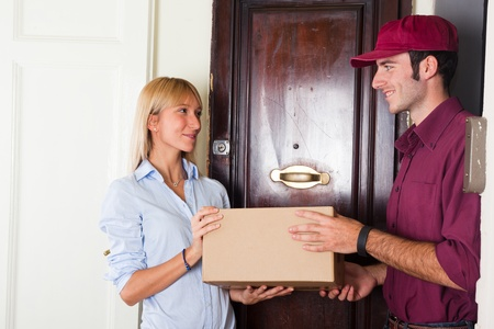 delivering: Delivery Boy with Box for Young Woman