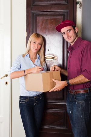 Delivery Boy with Box for Young Woman photo