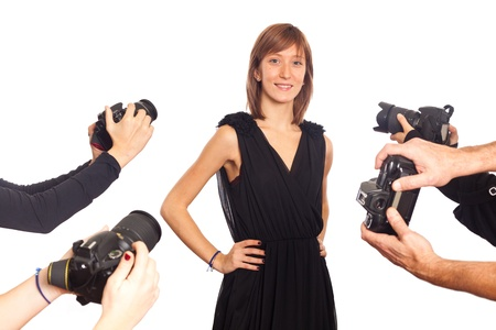 Celebrity Woman in front of Paparazzi Stock Photo