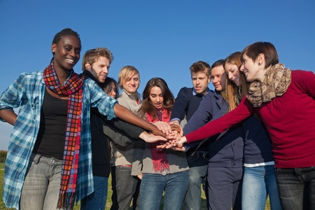 Happy College Students with Hands on Stack Stock Photo - 8577052