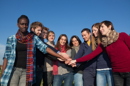 Happy College Students with Hands on Stack Stock Photo - 8577044