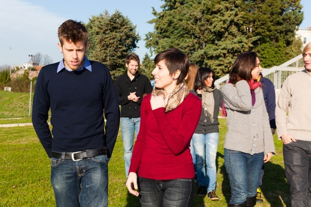 College Students Walking and Talking at Park photo