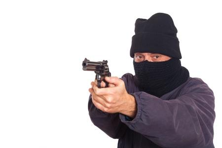 Thief Aiming a Gun on a Robbery Stock Photo - 8624640